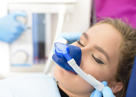 Patient with nitrous oxide sedation dentistry mask in place